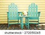 Two Empty Blue Wood Adirondack...