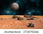 Small photo of A robotic rover explores the surface of a rocky and barren alien world. A large cratered moon rises over the airless environment. - Elements of this image furnished by NASA.