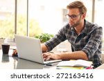 young man with glasses working... | Shutterstock . vector #272163416