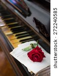 red rose and old piano | Shutterstock . vector #272240585
