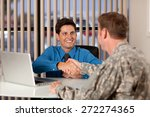 Businessman and soldier shaking hands