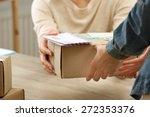 Woman Gives Parcel In Post...