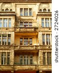 Old apartment building in Berlin, about 100 years old, never been renovated - stock photo