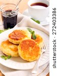 Small photo of Quark cheese fried cakes and cup of tea