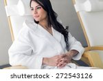 Small photo of Portrait of a beautiful young healthy woman relaxing in a robe