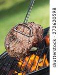 beef steak on grill | Shutterstock . vector #272620598