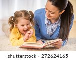 young mother is reading a book... | Shutterstock . vector #272624165