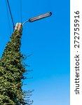 Small photo of power pole street light blue sky as a symbol of power grid, green energy, alternative energy