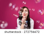 playful woman blowing party... | Shutterstock . vector #272756672