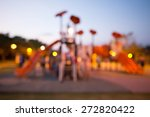 Blurred and defocused image for background of children's playground,activities at public park at night - stock photo