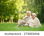 Elderly Couple Sitting Togethe...