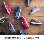 various running shoes laid on a ... | Shutterstock . vector #273083795