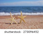 Starfish On The Beach With...