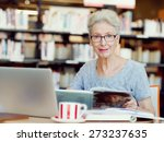 elderly lady working with laptop | Shutterstock . vector #273237635