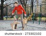 girl in orange jacket plays... | Shutterstock . vector #273302102