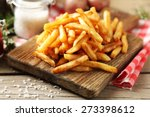 Tasty French Fries On Cutting...