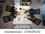office workers gather around a... | Shutterstock . vector #273429152
