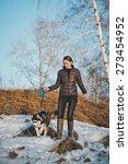 Stock photo the girl walks a dog 273454952