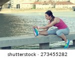 woman stretching her leg by the ... | Shutterstock . vector #273455282