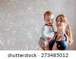 sportive young redheaded mother ... | Shutterstock . vector #273485012