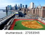 View of downtown Manhattan with Brooklyn Bridge, Financial District and Baseball field - stock photo