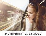 pensive young girl on the train ... | Shutterstock . vector #273560012