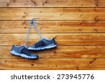 Pair Of Sport Shoes Hang On A...