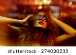 Stock photo dark color toned picture of fashionable woman in nightclub 274030235