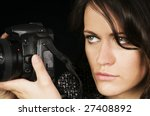 Dramatic Close-up of Female Photographer/Photo-Journalist w/SLR. - stock photo