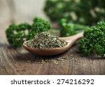 dried parsley in wooden spoon... | Shutterstock . vector #274216292