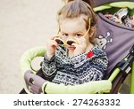 Cute Toddler Girl Sitting In...