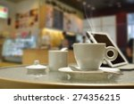 cup of coffee with smoke and... | Shutterstock . vector #274356215