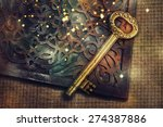 magic book with gold vintage key | Shutterstock . vector #274387886