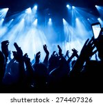 silhouettes of concert crowd in ... | Shutterstock . vector #274407326