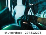 Auto Theft Carjacking. Young Caucasian Male Carjacker in Black Mask Driving Stolen Car. Motor Vehicle Theft Concept Photography. Grand Auto Theft. - stock photo