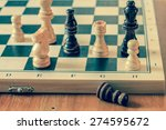Chess pawns on wooden table, game and strategy concept, vintage photography. - stock photo