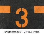 The Number 3 Printed On The Road