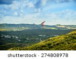 Hang Glider Flying Over The...