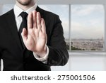Small photo of businessman in office room hand stop gesture