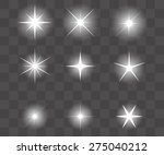 set of vector glowing light... | Shutterstock .eps vector #275040212