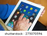 senior woman using tablet with... | Shutterstock . vector #275070596