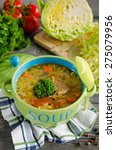 Small photo of Shchi - traditional russian cabbage soup on a wooden table. Style rustic. Selective focus