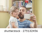 young father with his cute... | Shutterstock . vector #275132456