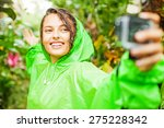 Woman Wearing A Raincoat Takin...