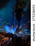 robots welding in a car factory | Shutterstock . vector #275238452