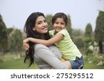 portrait of a mother holding... | Shutterstock . vector #275295512