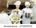 cook gives to girl waitress... | Shutterstock . vector #275339552