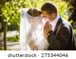 happy bride and groom on their... | Shutterstock . vector #275344046