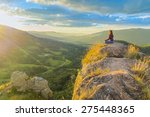 woman meditating on top of a... | Shutterstock . vector #275448365