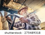Senior Man At The Farm Driving...